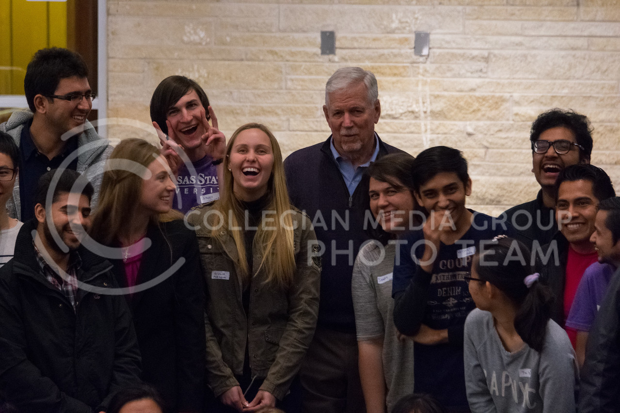 Everyone laughs as President Myers cracks a joke before taking a silly group picture at the Conversation Cafe in the union courtyard on February 28, 2018. (Alex Todd   Collegian Media Group)