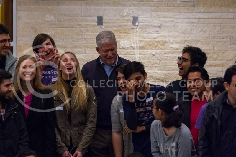 Everyone laughs as President Myers cracks a joke before taking a silly group picture at the Conversation Cafe in the union courtyard on February 28, 2018. (Alex Todd | Collegian Media Group)