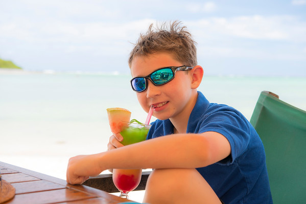 "Alex enjoying a tropical ""stop light"" drink at Muri Beach in Rarotonga"