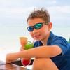 """Alex enjoying a tropical """"stop light"""" drink at Muri Beach in Rarotonga"""