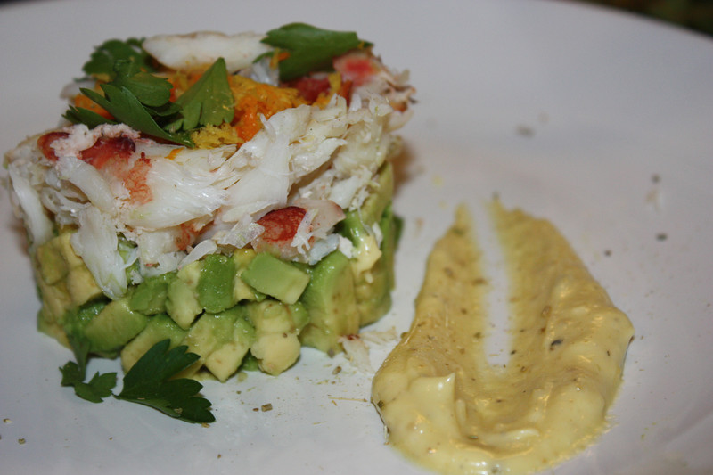 "Dungeness Crab & Avocado Salad by Sondra Bernstein (from her book ""Plats Du Jour: the girl & the fig's juorney through the seasons in wine country)<br /> <br /> INGREDIENTS:<br /> For the aioli:<br /> 1 large egg yolk<br /> 1 1/2 teaspoons fresh lemon juice<br /> 1/2 teaspoon fenned seed, toasted and ground<br /> Pinch of salt<br /> 1/2 cup blended oil (3 parts canola oil and 1 part extra-virgin olive oil)<br /> <br /> For the salad:<br /> 2 avocados<br /> 1 1/2 teaspoons fresh lemon juice<br /> 6 orange segments<br /> 6 ruby grapefruit segments<br /> 9 ounces Dungeness crabmeat<br /> Zest of 1 lemon<br /> Zest of 1 orange<br /> 1 teaspoon fennel pollen<br /> 1/2 cup whole parsley leaves<br /> Salt and white pepper to taste<br /> <br /> DIRECTIONS:<br /> To prepare the aioli:<br /> Place the egg yolk, lemon juice, fennel seed, and a pinch of salt in a stainless steel bowl.  Slowly drizzle the blended oil into the bowl, whisking rapidly until all the oil is incorporated and the mixture is thick.  If the mixture becomes too thick, add a few teaspoons of water if needed.  Season with salt and pepper to taste.  Refrigerate and set aside.<br /> <br /> To prepare the salad:<br /> Dice the avocados into 1/2-inch pieces and toss them with the lemon juice and seaon with salt and white pepper to taste.<br /> <br /> Place a 2 1/2-inch ring mold or cookie cutter on a plate and distribute the avocado equally among the ring molds.  Cover the avocado with the grapefruit and orange segments and top with 3 tablespoons of the crabmeat.  Repeat with the remaining plates.<br /> <br /> Garnish each plate with the fennel aioli, citrus zest, fennel pollen, and parsley leaves.  Serve immediately.<br /> <br /> JOHN'S NOTES:<br /> Renee' and I went to Sonoma for a vacation one year and this was one of the restaurant's we tried (the girl & the fig).  It was pretty incredible.  Flash forward several years and we find that the chef did a cookbook.  This is an excellently formatted book.  Each season (fall, spring, ect) gets several meals (which includes an appetizer, main, desert and cheese course) assigned to it.  The meals are ""fancy"" but not unachievable to make.<br /> <br /> For this recipe I couldn't find fennel powder, so I just saved some of the ground up fennel seed to use for the garnish."