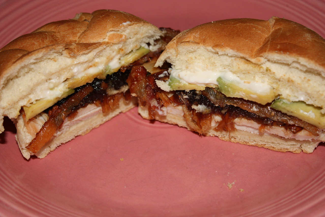ROASTED TURKEY WITH AVOCADO, BACON, BALSAMIC ONION MARMALADE, AND MAYONNAISE SANDWICHES by Tom Colicchio from his book 'wichcraft<br /> <br /> INGREDIENTS:<br /> 6 fresh sage leaves<br /> 1 (3- to 4-pound) boneless turkey breast<br /> 2 tbsp unsalted butter, softened<br /> Kosher salt and freshly ground black pepper<br /> 12 slices bacon<br /> 4 ciabatta rolls<br /> 1/2 cup Balsamic Onion Marmalade (recipe below)<br /> 1 ripe avocado, halved, pitted, peeled, and sliced<br /> 4 tbsp mayonnaise<br /> <br /> DIRECTIONS:<br /> Preheat the oven to 350 degrees<br /> <br /> Slide the sage leaves under the skin of the turkey breast and place the turkey on a sheet pan.  Rub the skin with the butter and season generously with salt and pepper.  Roast the turkey for 1 to 1 1/2 hours, until it reaches an internal temperature of 165 degrees.  Baste the meat with its juices throughout.  (Keep in mind that the meat will continue to cook even after it's removed from the oven, so be careful not to cook it too long.)  Allow the meat to rest before slicing, or cool completely.<br /> <br /> In a heavy skillet over medium-high heat, cook the bacon until golden brown and crisp on both sides.  Transfer to paper towels to drain.<br /> <br /> Slice the ciabatta rolls in half.  Place the turkey slices on the bottom halves and top with the marmalade.  Place the bottom and top halves of the rolls in the 350 degree oven and remove once the marmalade is heated through and the bread is toasted.  Top the marmalade with the bacon, followed by the avocado.  Evenly spread the mayonnaise on the top halves of the rolls.  Close the sandwiches, cut into halves, and serve.<br /> <br /> BALSAMIC ONION MARMALADE RECIPE (Makes 2 to 3 cups)<br /> INGREDIENTS:<br /> 1 tbsp vegetable oil<br /> 4 medium onions, thinly sliced (about 8 cups)<br /> Kosher salt and freshly ground black pepper<br /> 1/3 cup sugar<br /> 2/3 cup balsamic vinegar<br /> <br /> DIRECTIONS:<br /> Heat the oil in a large skillet over medium 