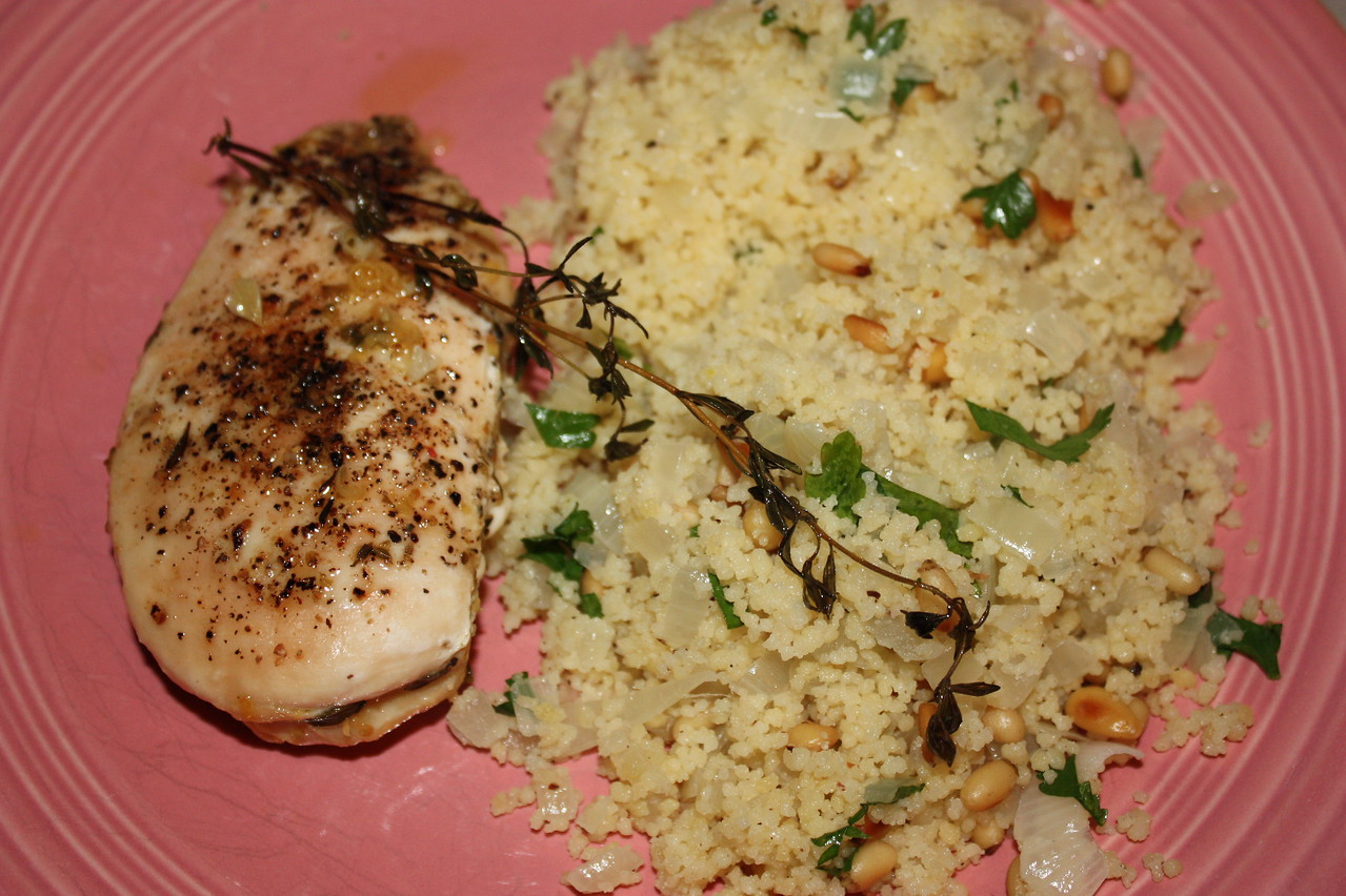"""Chicken with Goat Cheese and Basil by Ina Garten from her book """"Barefoot Contessa at Home""""<br /> <br /> INGREDIENTS:<br /> 6 boneless chicken breasts, skin on<br /> 8-10 oz garlic-and-herb goat cheese, such as Montrachet<br /> 6 large fresh basil leaves<br /> good olive oil<br /> kosher salt and freshly ground black pepper<br /> <br /> DIRECTIONS:<br /> Preheat the oven to 375 degrees.<br />      Place the chicken breasts on a sheet pan.  Loosen the skin from the meat with your fingers, leaving one side attached.  Cut the goat cheese into 1/2-inch-thick slices and place 1 or 2 slices plus a large basil leaf under the skin of each chicken breast.  Pull the skin over as much of the meat as possible so the chicken won't dry out.  With your fingers, rub each piece with olive oil, then sprinkle them very generously with salt and pepper.  Bake the chicken for 35 to 40 minutes, until the skin is lightly browned and the chicken is just cooked through.  Serve hot or at room temperature.<br /> <br /> <br /> Couscous with Toasted Pine Nuts by Ina Garten from her book """"Barefoot Contessa: How Easy is That?""""<br /> <br /> INGREDIENTS:<br /> 4 tablespoons unsalted butter<br /> 2 cups chopped yellow onion (2 onions)<br /> 3 cups chicken stock<br /> 1 1/2 teaspoons kosher salt<br /> 1/2 teaspoon freshly ground black pepper<br /> 2 cups couscous (12 ounces)<br /> 1/2 cup pine nuts, toasted<br /> 1/2 cup minced fresh parsley<br /> <br /> Note: To toast the pine nuts, pleace them in a dry saute pan and cook over low heat for 10 minutes, tossing often, until lightly browned.<br /> <br /> DIRECTIONS:<br /> Melt the butter in a large saucepan.  Add the onion and cook over medium-low heat for 8 to 10 minutes, stirring occasionally, until tender but not browned.  Add the chicken stock, salt, and pepper and bring to a full boil.  Stir in the couscous, turn off the heat, cover, and allow to steam for 10 minutes.  Fluff with a fork, stir in the pine nuts and parsley, and serve hot."""