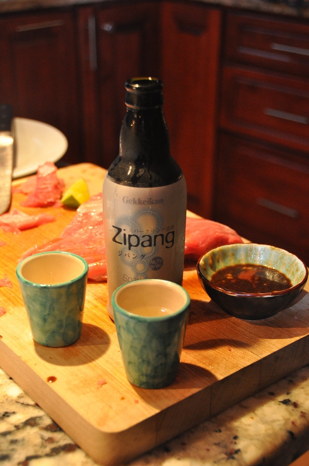 """In case you are interested the """"naturally sparkling sake"""" is a drink called Zipang made by Gekkeikan - served ice cold  it is crisp, light and refreshing - the best of champagne and beer all in one."""