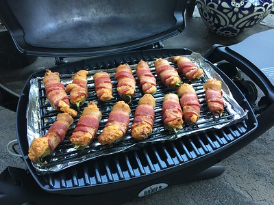 Bacon-wrapped jalapeños stuffed w/chipotle cream cheese