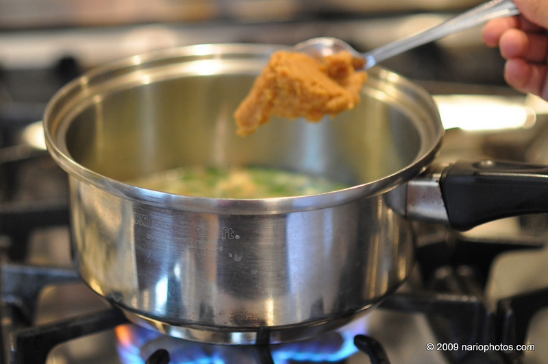 Wait a few minutes(3-5) of this fast sizzling -- extracts the flavor into the liquid --- but make sure the broth doesn't evaporate (cover and check often - adding broth as needed).<br /> <br /> Pour in the rest of the broth and add a nice whallop of miso (a large overflowing tablespoon or so). Don't over do it. If you can NOT find the brand I use (it's mild) be careful. I used a brand in FLA (with a karate guy in cover) that was very strong.<br /> <br /> After it boils again, lower the heat to lowest setting and cover tightly.<br /> Let it simmer for 10+ minutes.