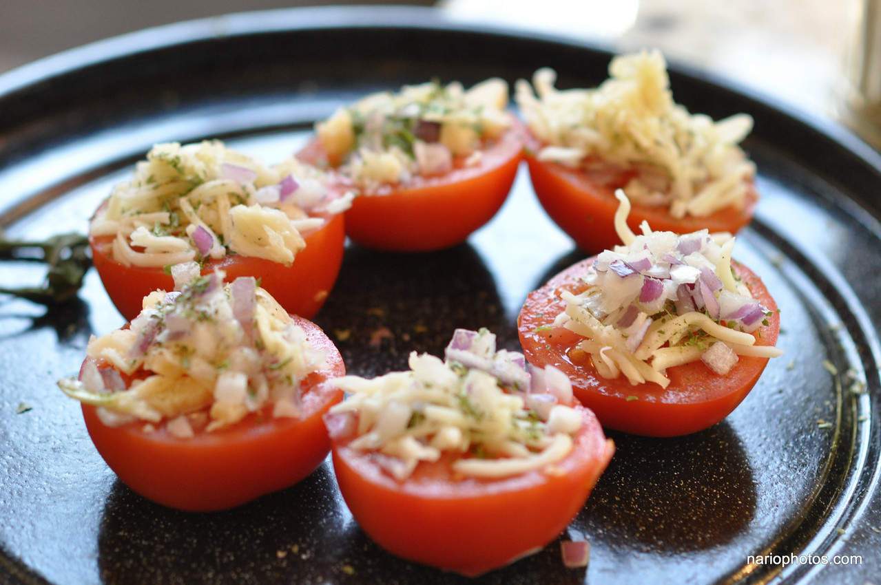 "I started with the <a href=""http://nario.com/blog/2009/02/16/im-on-a-tomato-kick/"" target=""_blank"">'I'm on a tomato kick blog entry I made'</a> recipe and went on from there. I only had smaller tomatoes on day 1 (a second day at end).   Be careful cutting them. If you end up with a sloped surface (like I did) it will be harder to put the toppings."