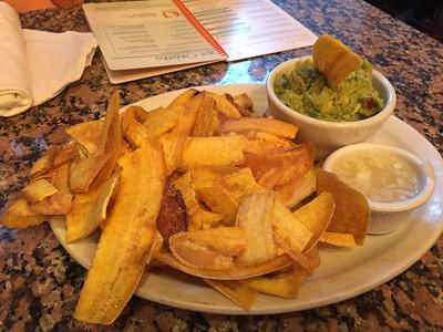 Plantain chips, guacamole and mojo sauce.