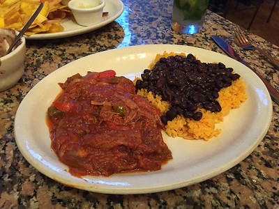 Ropa vieja, yellow rice and black beans.