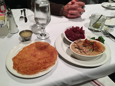 Veal Stroganoff, potato pancake and red cabbage.