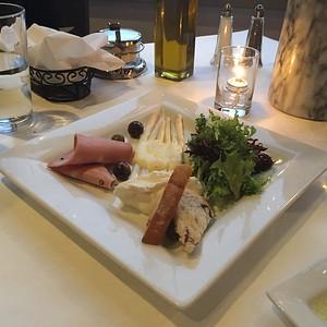 Antipasti Veneziano - mortadella, white asparagus, buratta cheese, olives, bruschetta and fresh greens.