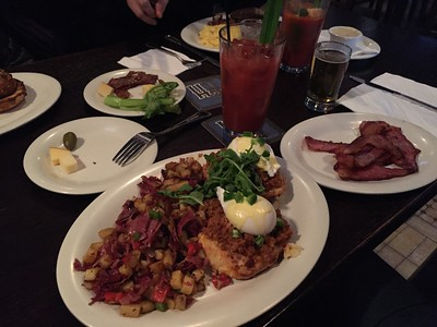 Chorizo benedict w/jalepeño hollandaise, pastrami hash, bacon and bloody mary.