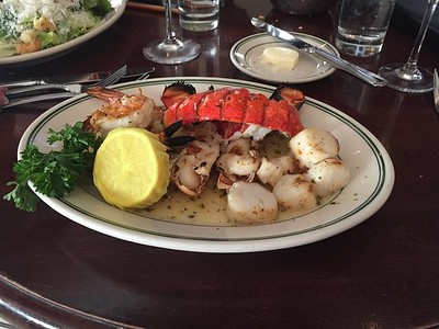 Grilled seafood platter - lobster tails, scallops and shrimp in drawn butter