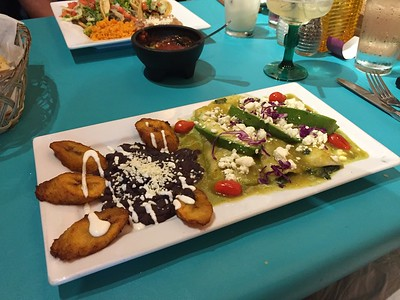 Popeye's Favorite Enchiladas - spinach and poblano pepper stuffed enchiladas w/avocado, tomato, sweet plantains and refried black beans