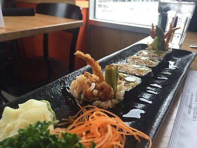 Spider Roll - soft shell crab tempura, massage, avocado, asparagus and unagi sauce.