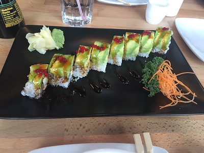 Packer Roll - baked salmon, cream cheese, spicy mayo and crunchy tempura topped with red tobiko, avocado & unary sauce.