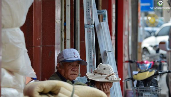 Having a sit down outside a shop in Beijing
