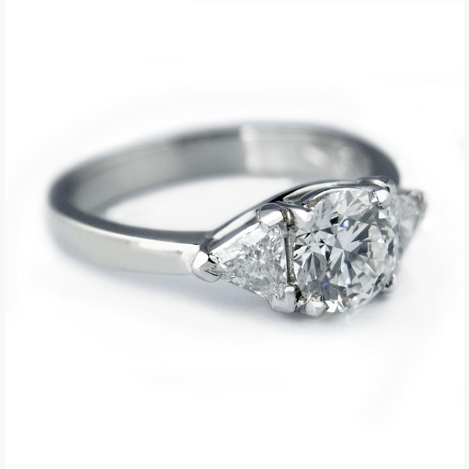 Brilliant cut diamond engagement trillian ring