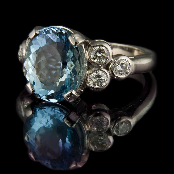 Aquamarine fleur-de-lis engagement ring
