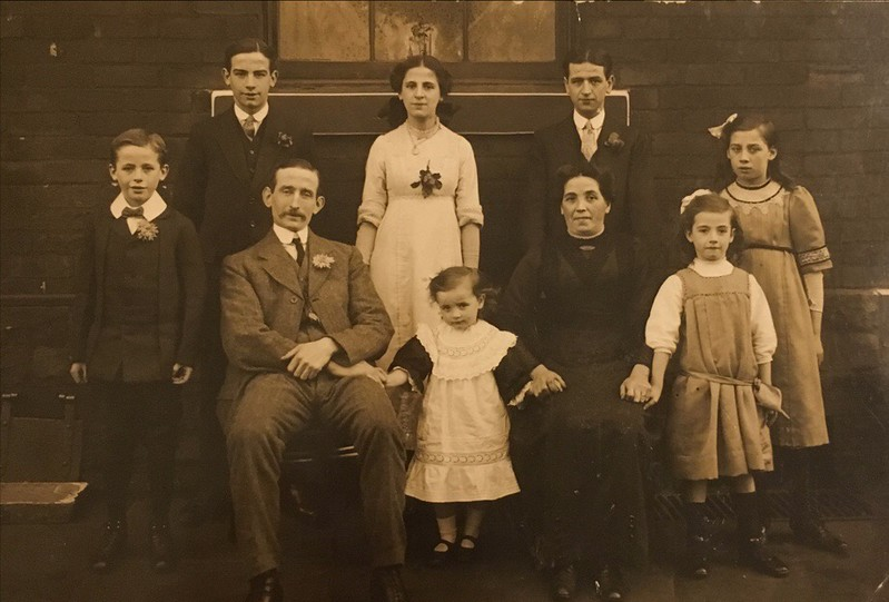 Grandma and Grandad and (L-R) Arthur, Charlie, Nellie, Sidney, Alice, Lily and Mary in the middle