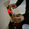 KRISTOPHER RADDER — BRATTLEBORO REFORMER<br /> Blake Amacker, co-owner of Copper Cannon, in Chesterfield, N.H., fills an 8oz bottle with hand sanitizer products that they make because of the COVID-19 pandemic on Friday, April 24, 2020. Amacker gives the first bottle of hand sanitizer away for free with a suggested donation that they give to local restaurants.