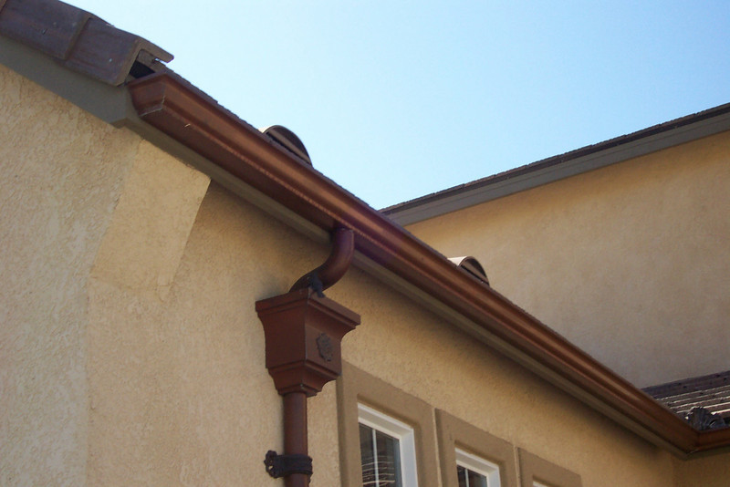 "Mitered endcaps on 5"" k style copper gutters, # 9 leaderhead with Rose ornament."