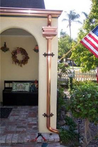 """ K "" or Ogee style gutters, Wagner style leaderhead, return endcaps, fluer-dis-lis downspout brackets and a custom extended ornate foot."