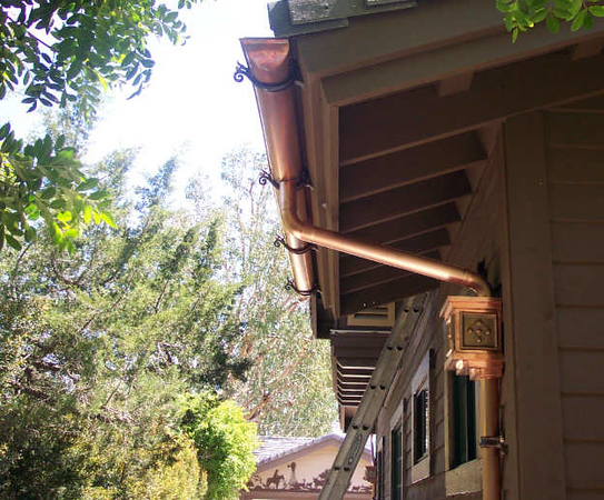 "This shows "" return ends "" on half round gutters. These are one of the more difficult and time consuming tricks with half round gutters.<br /> Cubic panel leaderheads and cast bronze gutter and downspout hangers with patina and polishing, Rancho Santa Fe, CA.<br /> I have an extensive "" how to "" section that is available on a pay-per-view basis. Ask for details."