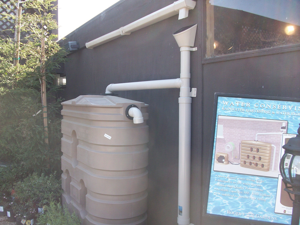 "Display shows a cut away view of the first flush.  The blue ball in the PVC pipe acts as a float allowing the first few gallons of dirty water to be diverted away from the tank. <a href=""http://www.rain-watersystems.com/"">http://www.rain-watersystems.com/</a>"
