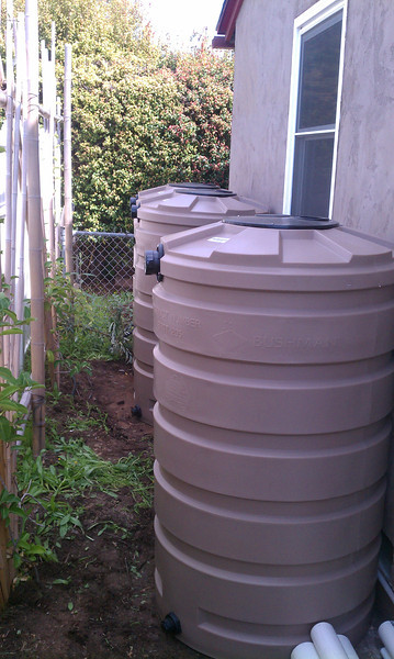 "Tanks in place, not yet hooked up to first flush devices and gutters..<br /> <br /> <br /> <br />  <a href=""http://www.rain-watersystems.com"">http://www.rain-watersystems.com</a>"
