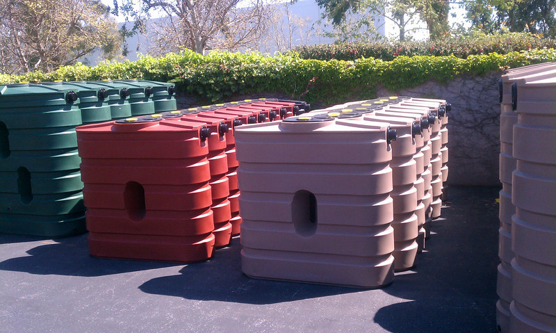 "Rows of 130 gallon slimline tanks waiting for a home.<br /> <br />  <a href=""http://www.rain-watersystems.com/"">http://www.rain-watersystems.com/</a>"