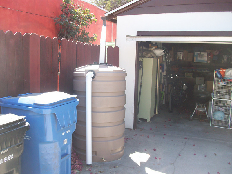 "This customer was experiencing flooding of her garage. When a large storm is expected she fixes drain pipe to the overflow and runs it to the street. <br /> No more garage flooding, and she has 205 gallons of water for emergency storage and gardening.<br />  <a href=""http://www.rain-watersystems.com/"">http://www.rain-watersystems.com/</a>"