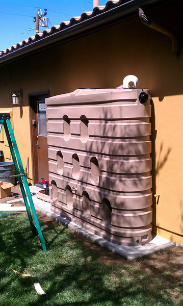 "The color of the slimline 620 gallon tank blended well with the stucco. <br /> <br />  <a href=""http://www.rain-watersystems.com/"">http://www.rain-watersystems.com/</a>"