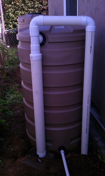 "First flush sediment trap place next to three 205 gallon Bushman round tanks.<br /> <br /> <a href=""http://www.rain-watersystems.com/wet-systems.html"">http://www.rain-watersystems.com/wet-systems.html</a>"