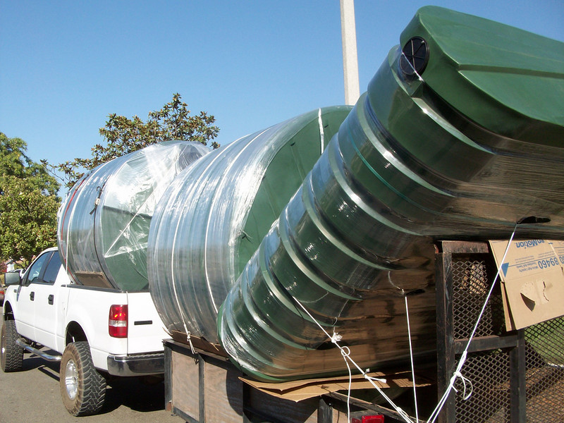 "Full load of green Bushman raintanks<br /> <br />  <a href=""http://www.rain-watersystems.com/"">http://www.rain-watersystems.com/</a>"