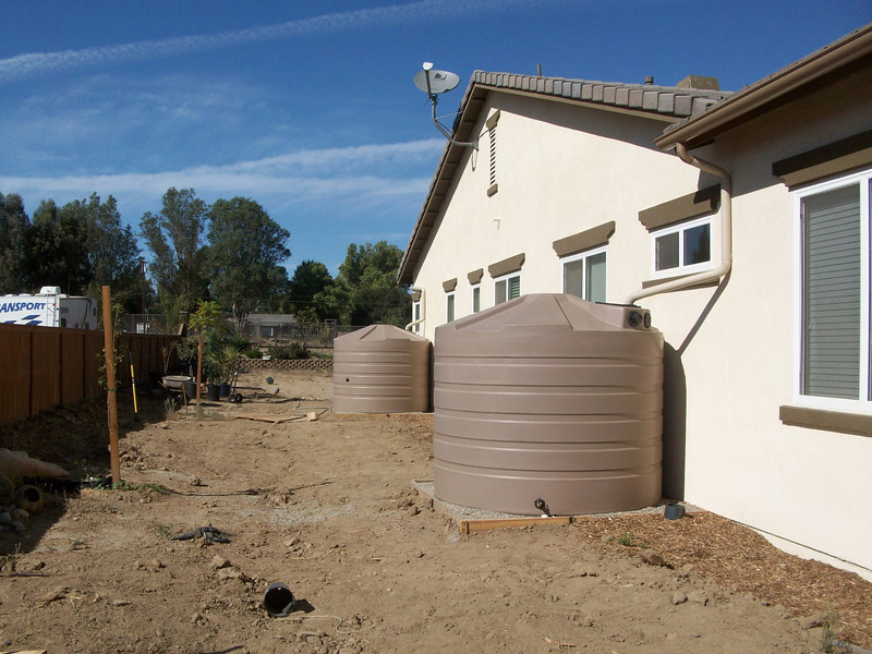 "Two 1250 gallon rain harvest tanks installed with seamless 6"" half round gutters in Murrieta, Ca. <a href=""http://www.rain-watersystems.com/"">http://www.rain-watersystems.com/</a>"