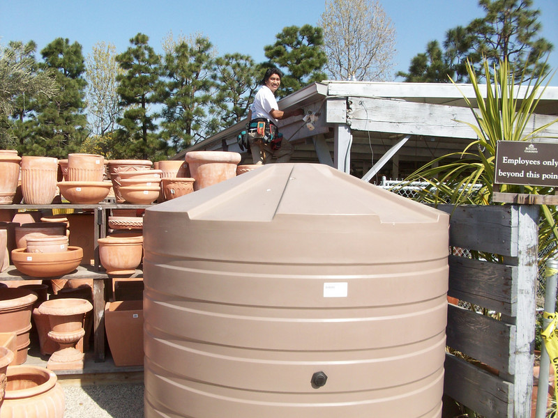"""Forty five feet of gutter drain into this tank that is used to water the rose bushes. <a href=""""http://www.rain-watersystems.com/"""">http://www.rain-watersystems.com/</a>"""