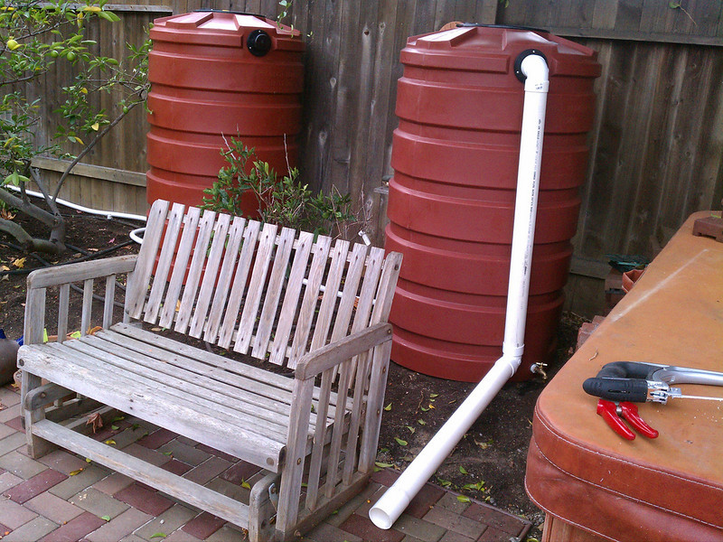 """The overflow from these Bushman 205 gallon rain barrels is directed onto a hardscape surface.<br /> <br />  <a href=""""http://www.rain-watersystems.com/"""">http://www.rain-watersystems.com/</a>"""
