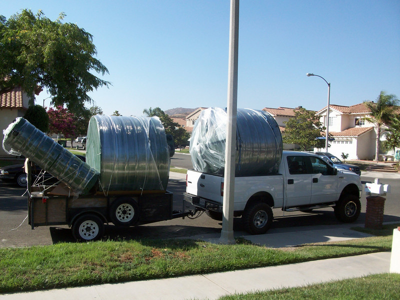 "Logistics of delivering tanks are difficult and create a visual spectacle. <a href=""http://www.rain-watersystems.com/"">http://www.rain-watersystems.com/</a>"