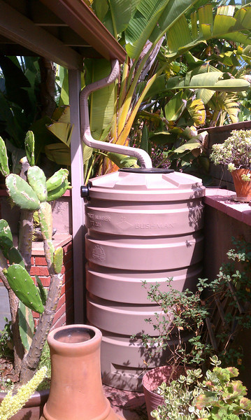 """Patio tank, 205 gallons, later placed outside the fence.<br /> <br /> <br /> <br />  <a href=""""http://www.rain-watersystems.com"""">http://www.rain-watersystems.com</a>"""