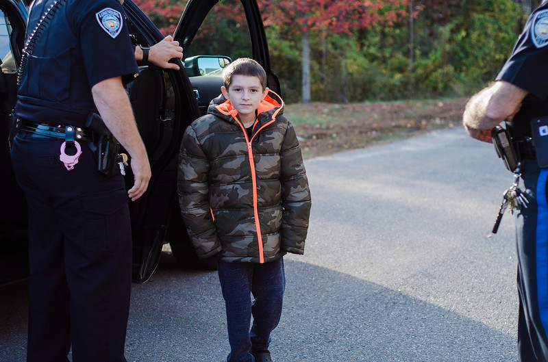 Members of the Lunenburg Police Department escort the Cotoni Family to the department for a check passing from Cops for Kids with Cancer on Friday, October 27, 2017. 11-year-old Brandon Cotoni has been battling Neuroblastoma since being diagnosed in November 2016. SENTINEL & ENTERPRISE / Ashley Green