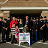 Paul Ivens, from Cops for Kids with Cancer, presents 11-year-old Brandon Cotoni with a check for $5,000 and a few small gifts at the Lunenburg Police Department on Friday, October 27, 2017. Brandon has been battling Neuroblastoma since being diagnosed in November 2016. SENTINEL & ENTERPRISE / Ashley Green