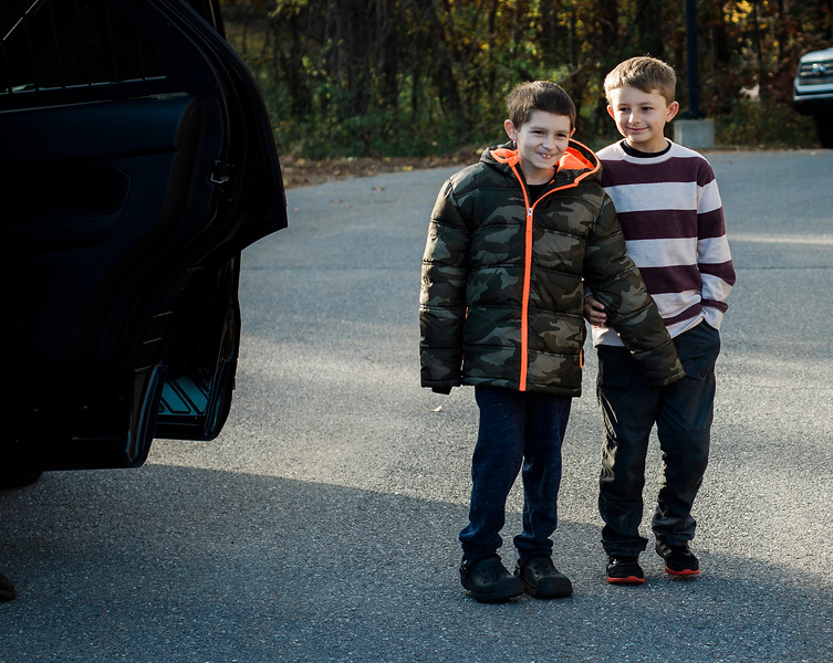 Members of the Lunenburg Police Department escort the Cotoni Family to the department for a check passing from Cops for Kids with Cancer on Friday, October 27, 2017. 11-year-old Brandon Cotoni, pictured with brother Cody, 11, has been battling Neuroblastoma since being diagnosed in November 2016. SENTINEL & ENTERPRISE / Ashley Green
