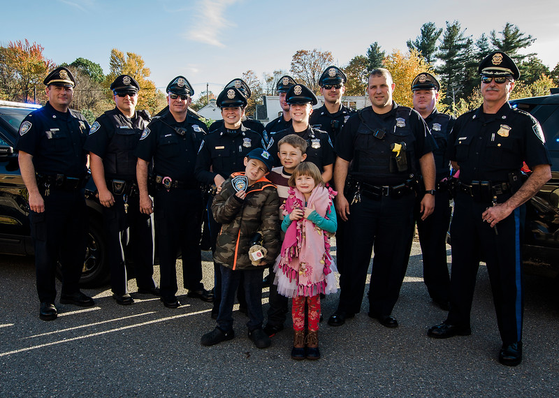 11-year-old Brandon Cotoni, along with siblings Cody, 11, and Kaylee, 6, was presented with a check for $5,000 from Cops for Kids with Cancer at the Lunenburg Police Department on Friday, October 27, 2017. Brandon has been battling Neuroblastoma since being diagnosed in November 2016. SENTINEL & ENTERPRISE / Ashley Green