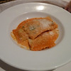 Spinach and ricotta ravioli in tomato sauce with parmsean