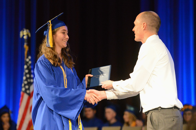 Matthew Harvey presents Ivy Cassady-Church with her diploma, May 24, 2018,  in Chico, California. (Carin Dorghalli -- Enterprise-Record)