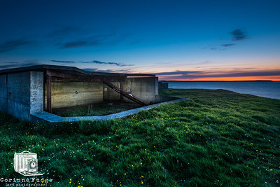 Concrete WW2 defences crumble away on a cliff overlooking the entrance to Kirkwall, Orkney. Image made at the summer solstice of 2012 - 0007hours on 20 June.
