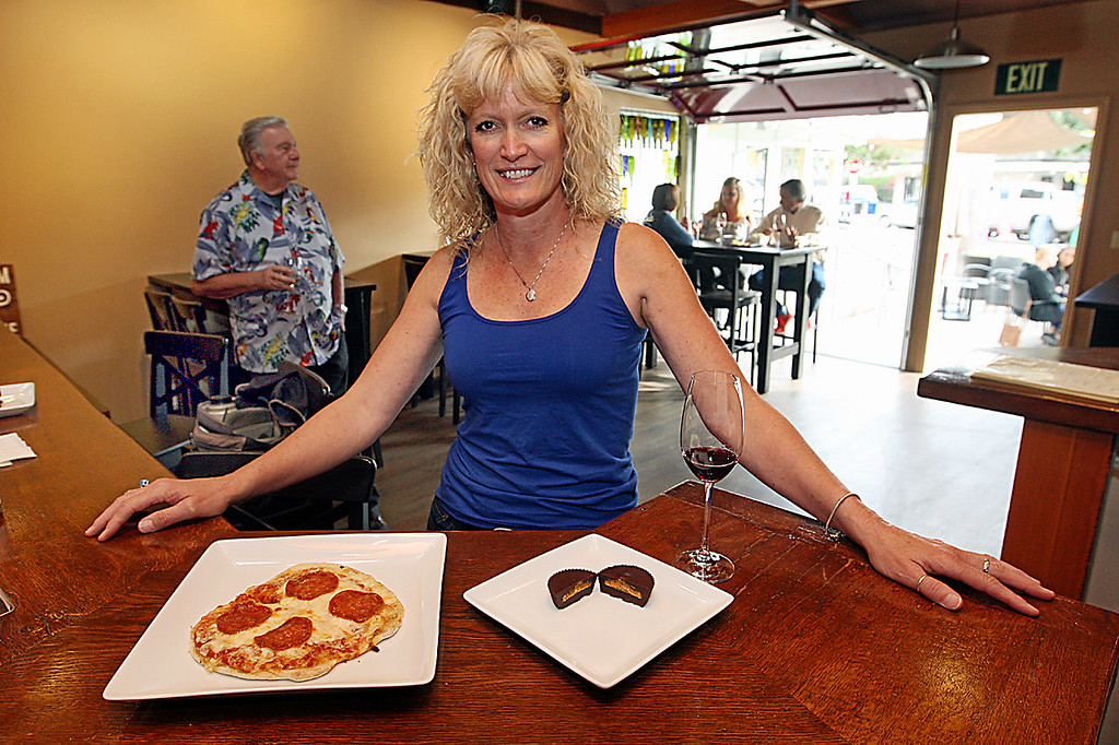 . Cathy Bentley recently opened her Cork & Fork wine bar in the heart of Capitola Village. (Dan  Coyro -- Santa Cruz Sentinel)