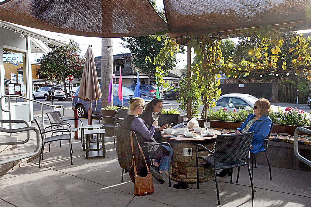 . The Cork & Fork wine bar patio opens up to the heart of Capitola Village. (Dan  Coyro -- Santa Cruz Sentinel)