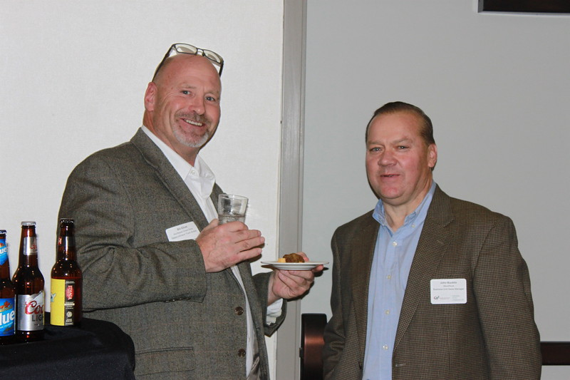 NDA Vice Pres. Bill Elliott from Great Dane left and John Bucklin Sales Mgr. from Westrock share a cocktail and networking.